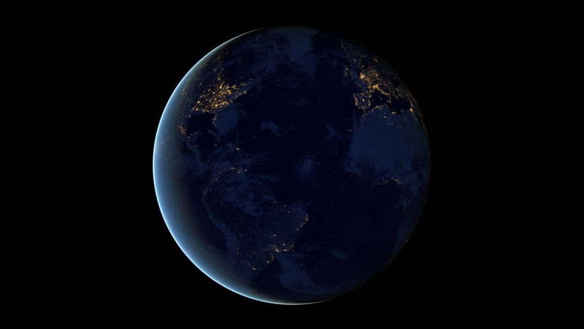 The night side of Earth twinkles with light in a composite pictures made using images from ...