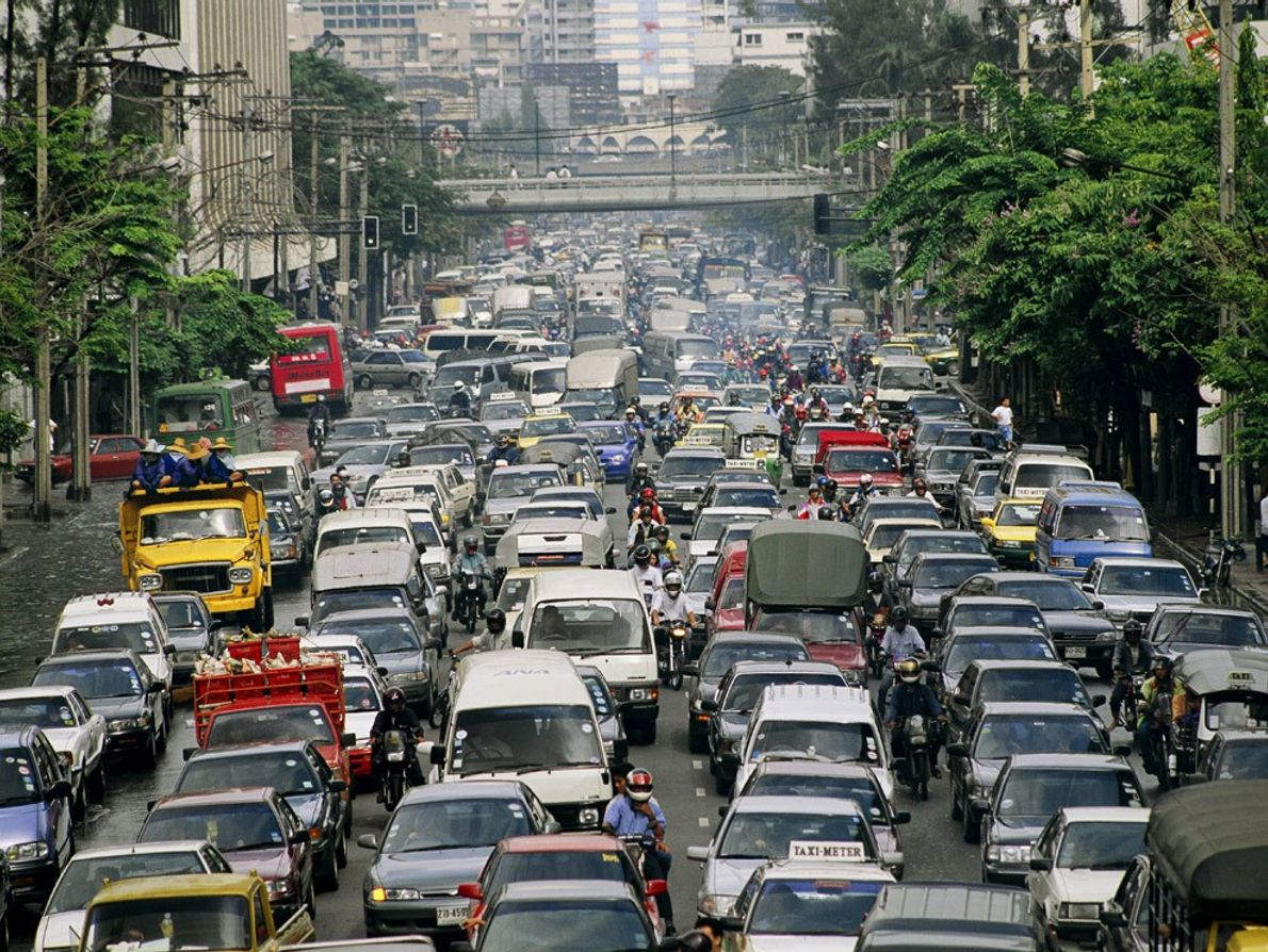 A traffic jam clogs the crowded streets of Bangkok, Thailand. Urban populations around the world have ...