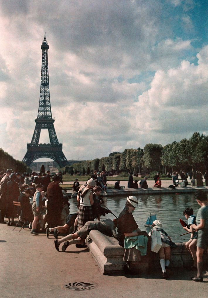 With the Eiffel Tower as backdrop, children sail toy boats in a pond in July 1936.
