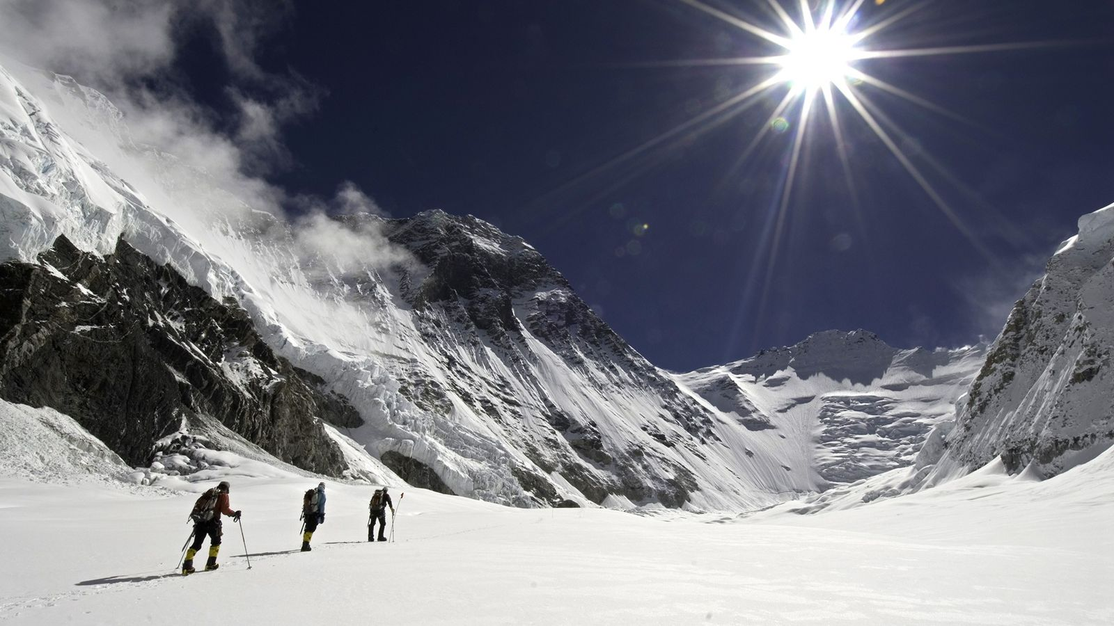 Members of the Altitude Everest Expedition 2007 cross a snowfield en route to the north side ...