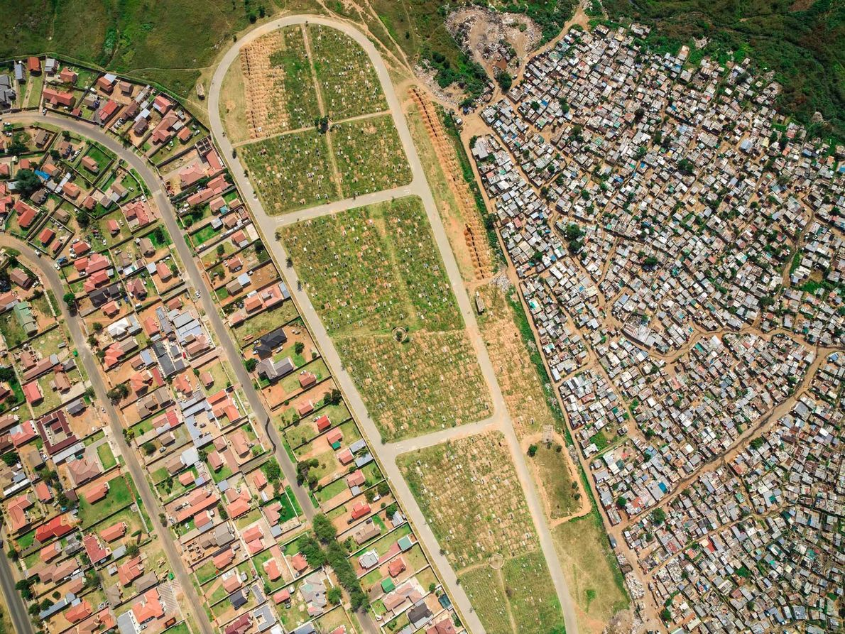 The Mooifontein cemetery divides the Vusimuzi informal settlement from the more affluent Tembisa housing development. Life ...