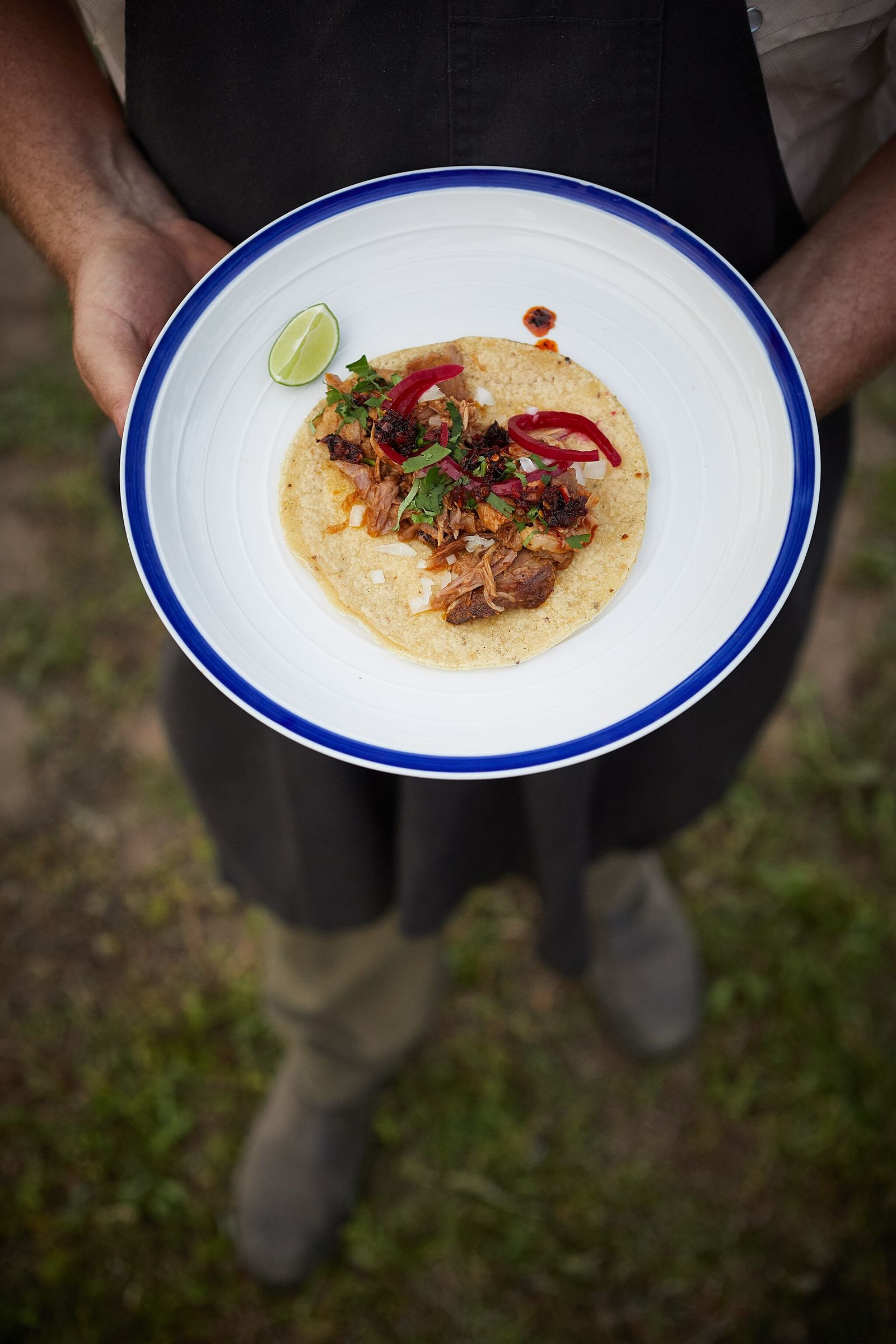 This wild boar carnitas was made from a recipe by Texas-based chef and hunter Jesse Griffiths. ...