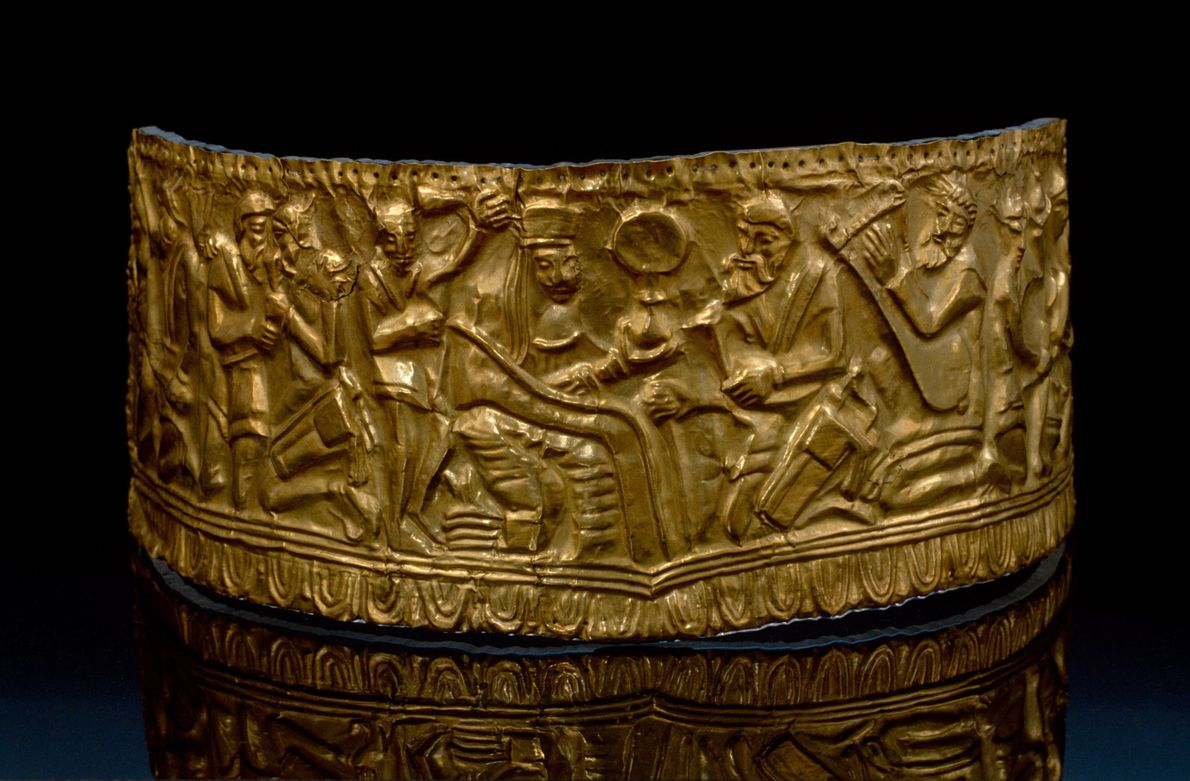 An ancient Scythian gold diadem with relief sculpture.