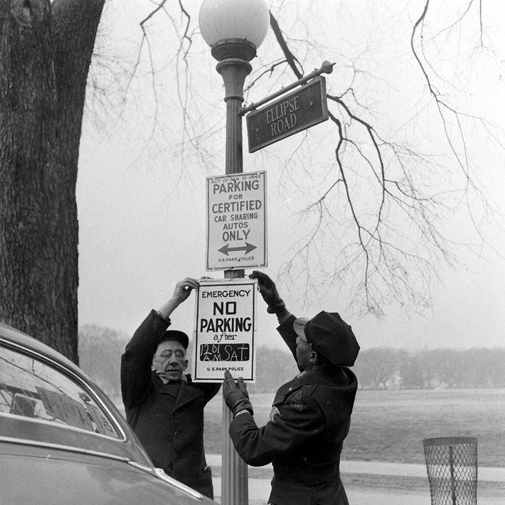 Officials install parking restriction signs in preparation for President Roosevelt's pared-down inauguration, which took place at ...