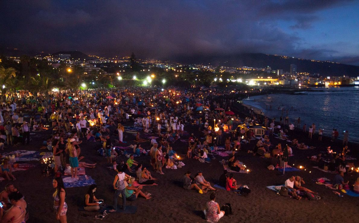 People celebrate the traditional Saint John night, which coincides with the summer solstice, with bonfires at ...