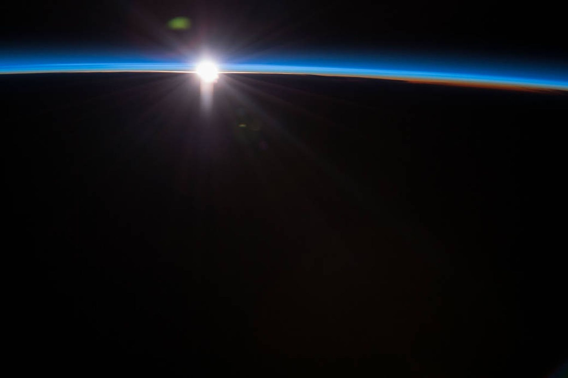 "Aboard the International Space Station astronauts have spectacular views of the Earth. NASA Astronaut Terry Virts, commander of Expedition 43, tweeted this comment with this image, ""Every #sunset is different, this one was blue""."