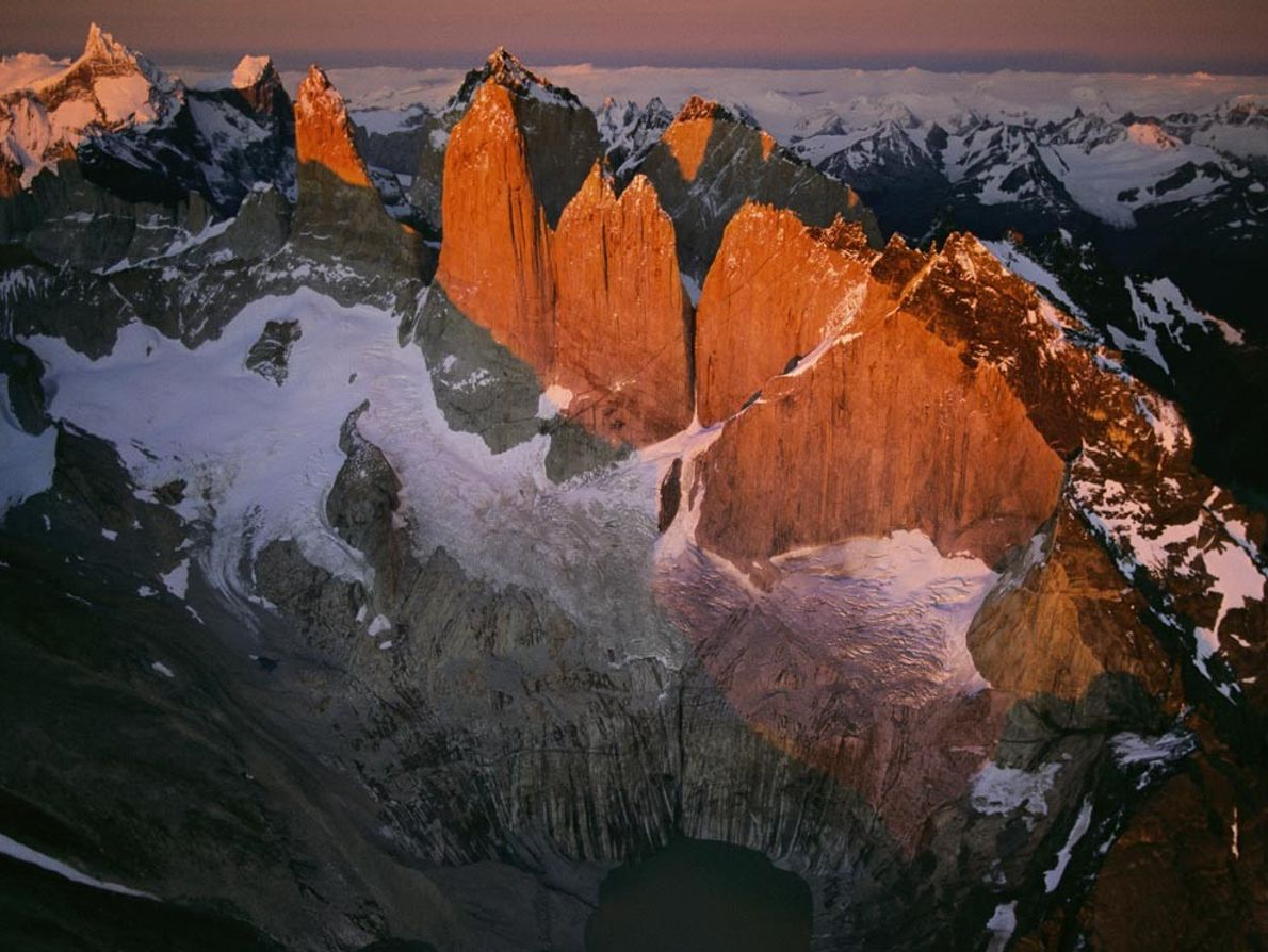 Sunrise warms the icy southern end of the Andes during a rare break in the weather ...