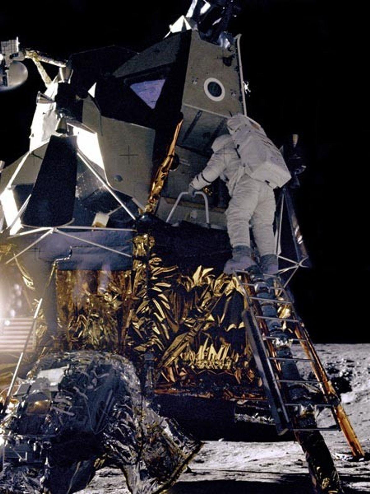 Apollo 12 astronaut Alan Bean descends from the lunar module Intrepid. When it reached the Ocean ...