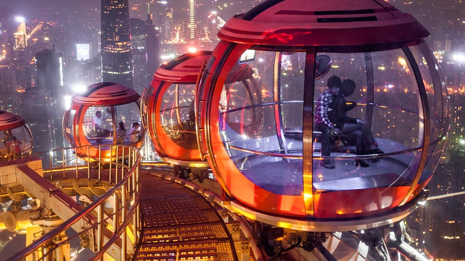 In China, rotating pods atop Guangzhou's Canton Tower overlook one of the world's most populous cities. ...