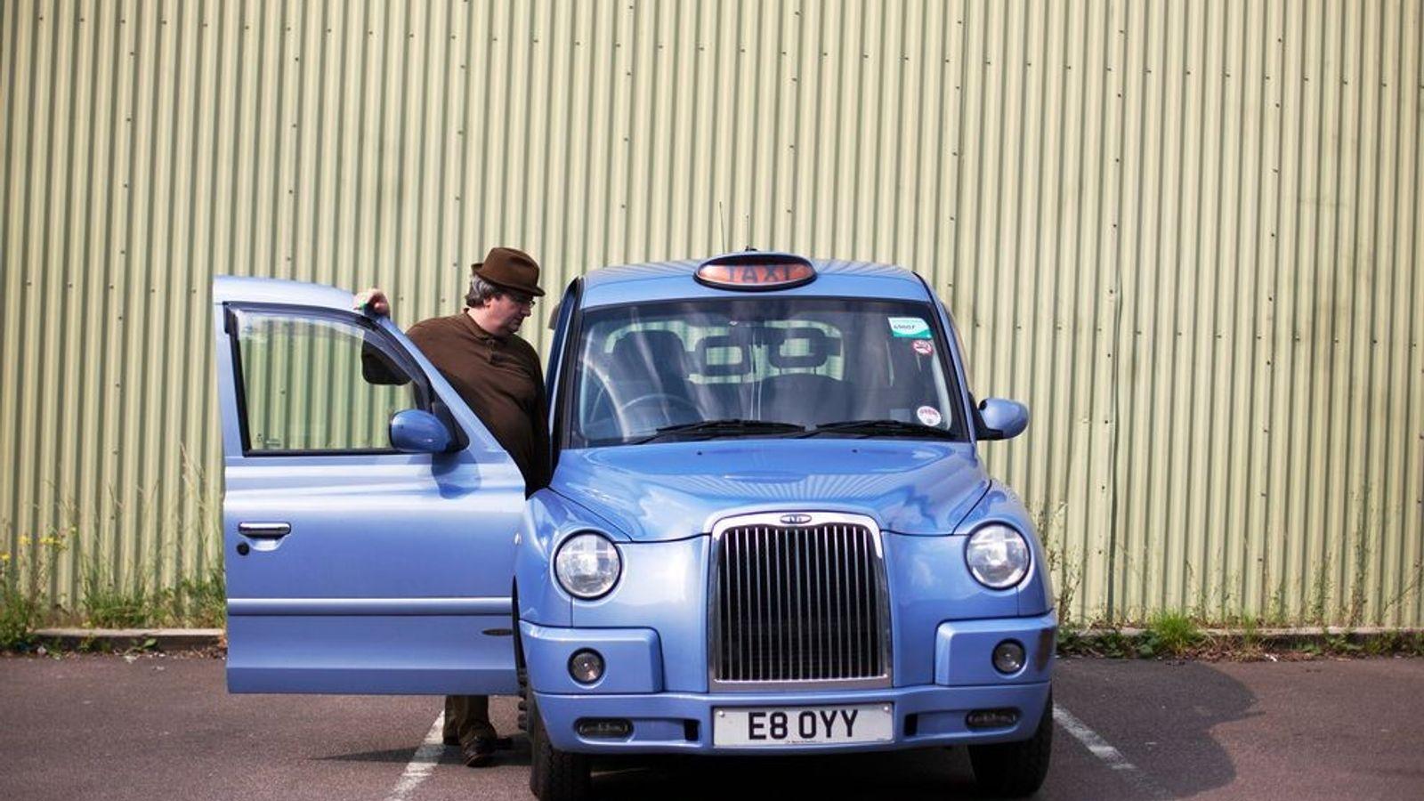 Veteran cabbie Ian Gordon alights from his cab at the KK Knowledge School to teach a ...