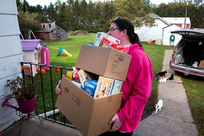 Christina Dreier brings home provisions from a charity in Mitchell County, Iowa. Despite the 133 billion ...