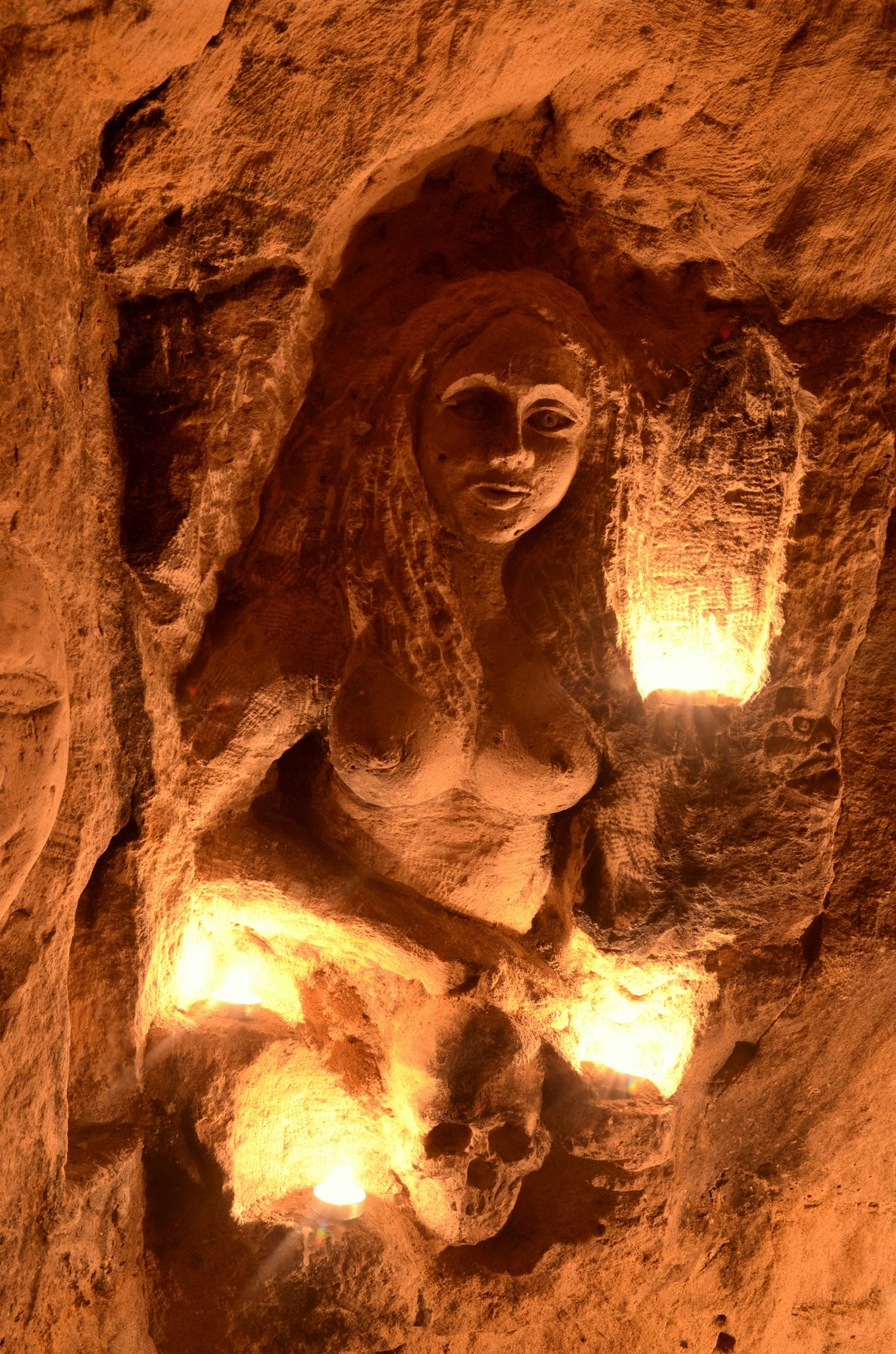 There are many sculptures in the catacomb system, where the soft limestone has been carved into …