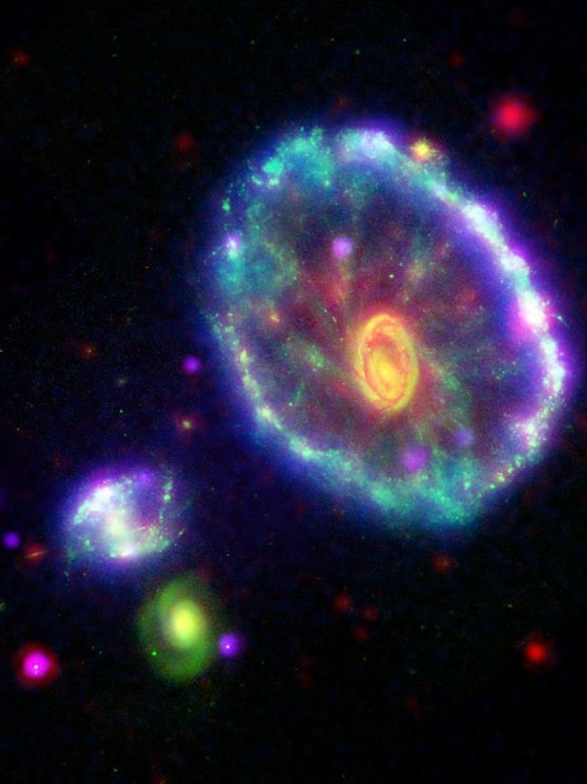 This false-colour view of the Cartwheel galaxy was created by combining images captured by four space ...