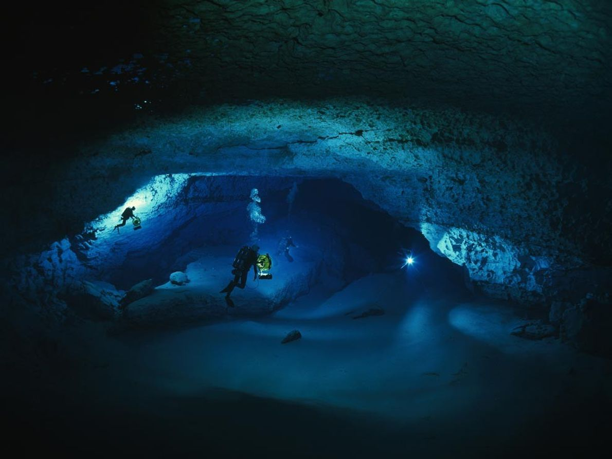 Cave divers explore a flooded chamber of Florida's Diepolder Cave, 76 metres (250 feet) below the ...