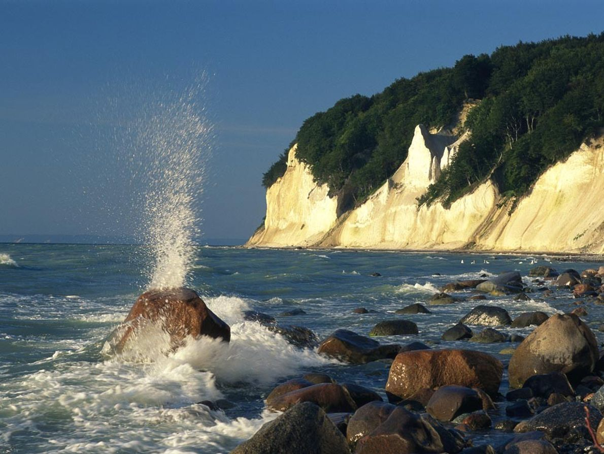 The chalk cliffs on Germany's Rügen Island rise 330 feet (100 meters) or more over the ...