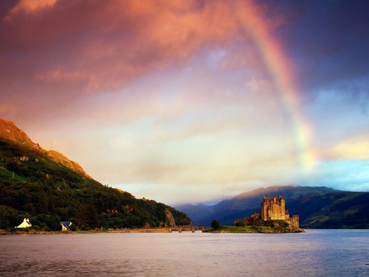 Widely considered Scotland's most photographed site, Eilean Donan Castle perches on an island at the meeting …