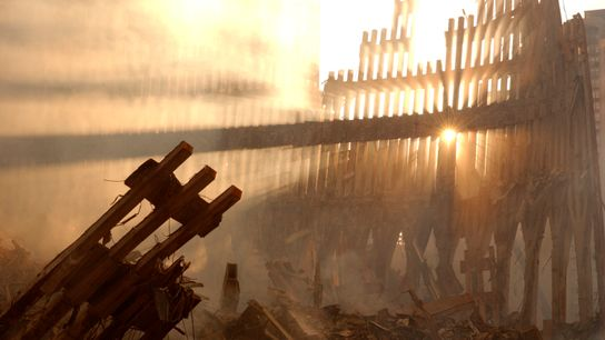 The sun shines through the ruins of the World Trade Centre, September 2001. Nearly 3,000 people ...