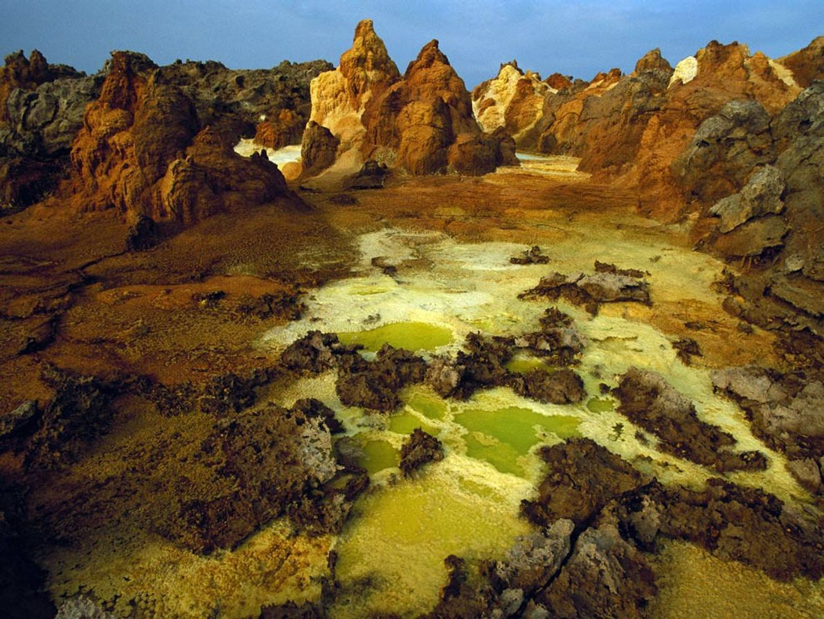 Sulphur, salt, and other minerals colour the crater of Dallol volcano, part of the Danakil Depression ...