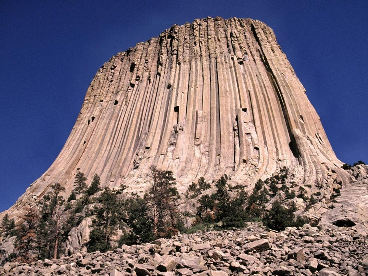 Known as an igneous intrusion, the 1,267-foot-tall (386-meter-tall) Devils Tower in Wyoming formed when molten rock ...