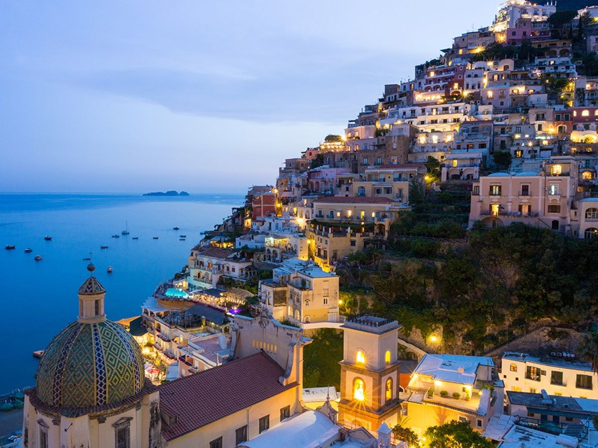 PERCHED POSITANO A staircase of homes tumbling down to the sea, Positano is one of Italy's most ...