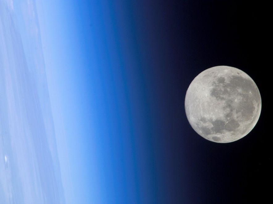 A full moon, captured in 2005 by a crew member of the International Space Station, appears ...