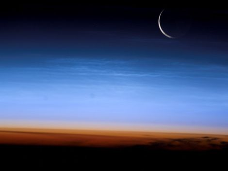 Why does Earth have a moon, and how does it affect our planet?