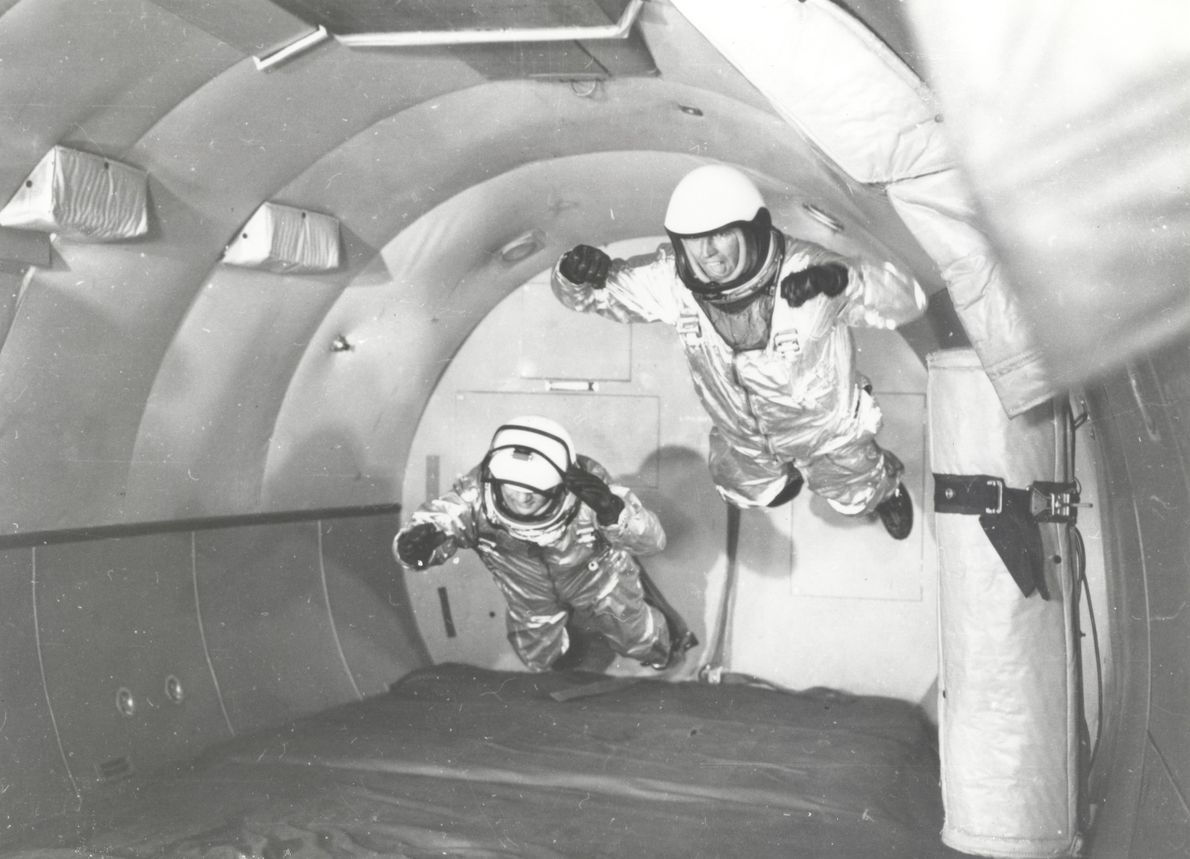 Astronauts in simulated weightless flight in C-131 aircraft flying 'zero-G' above Wright Air Development Centre, Ohio, 1959. Conducted ...