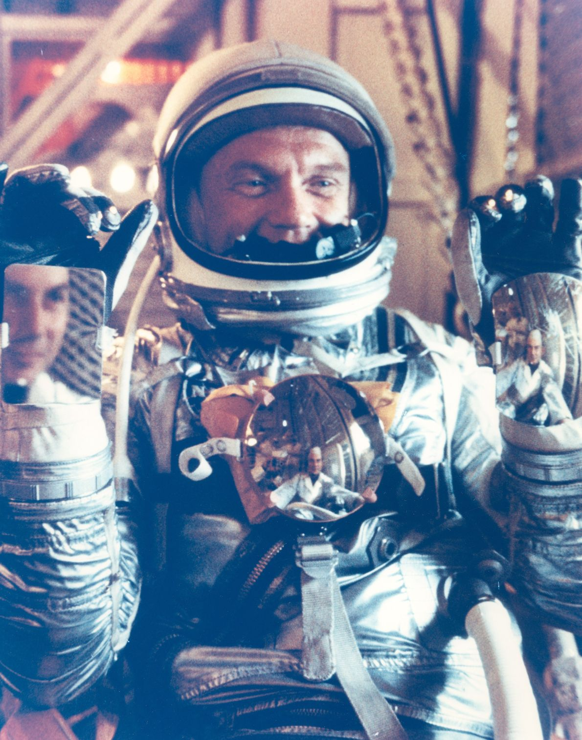 John Glenn poses in his Mercury suit. The mirrors were to allow the astronaut to view ...