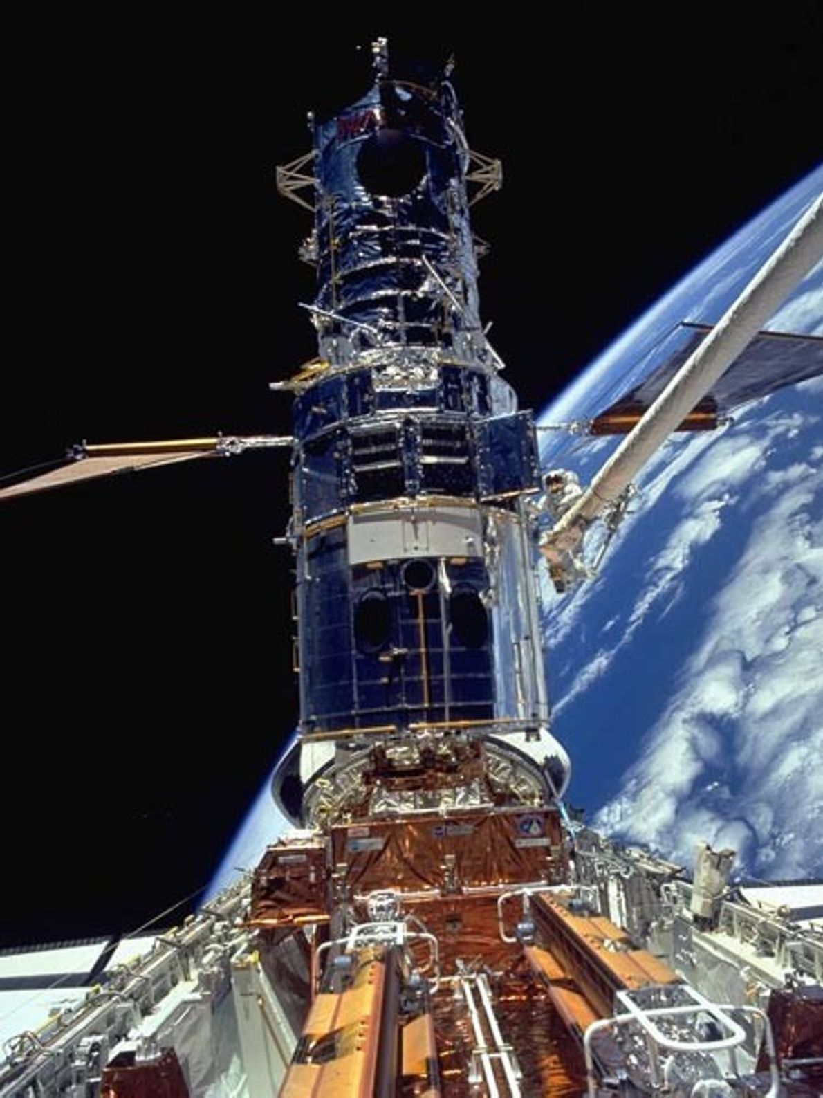 At 43.5 feet (13.2 meters) tall, the Hubble Space Telescope towers over space shuttle Endeavour's payload ...