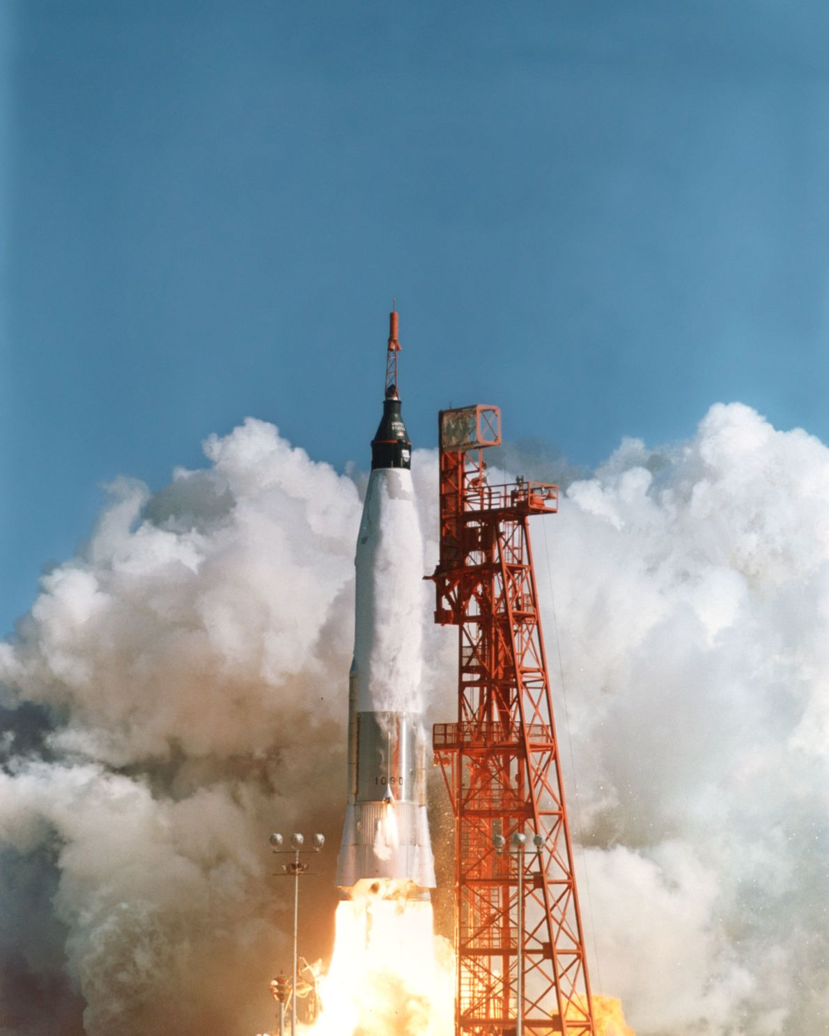 John Glenn launches in the Mercury-Atlas 6; the mission would last 4 hours and 55 minutes.