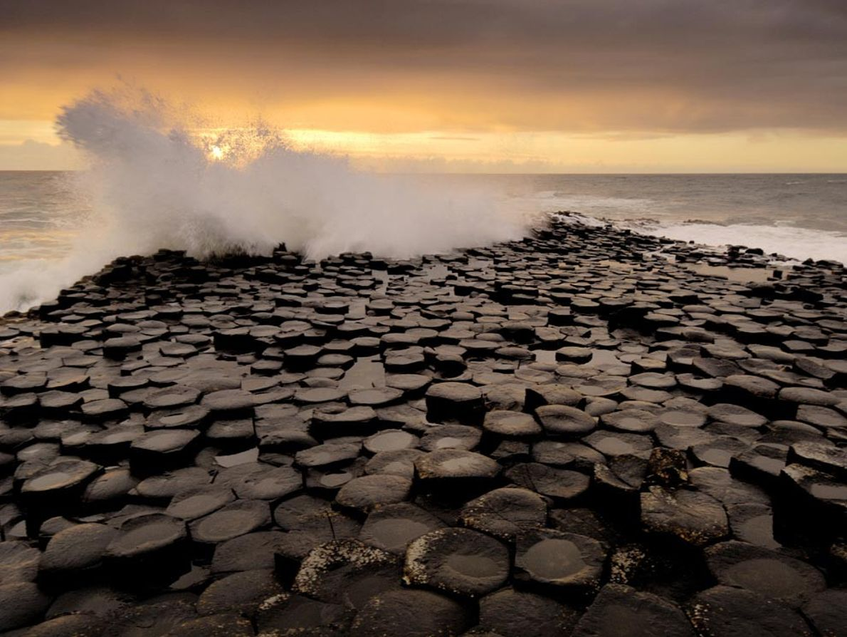 Stepping stones into the sea, these basaltic columns of the Giant's Causeway in Northern Ireland formed ...