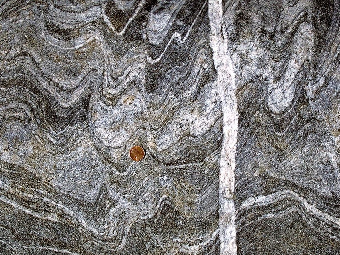 As if an avant-garde painting, younger white rock intrudes in a tapestry of gneiss. Since the ...