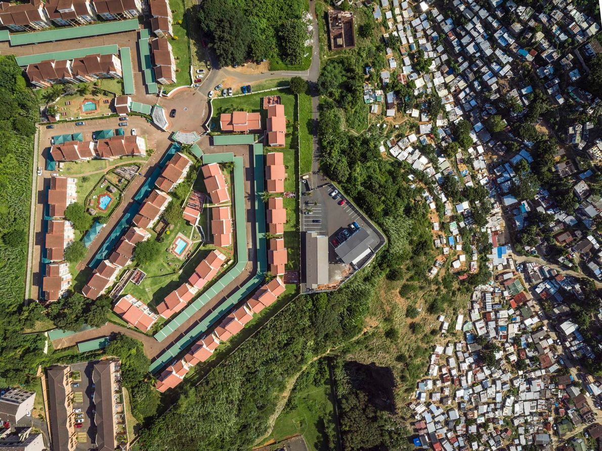 A wealthy community sits on a steep hill above the Umgeni River in Durban, a city ...