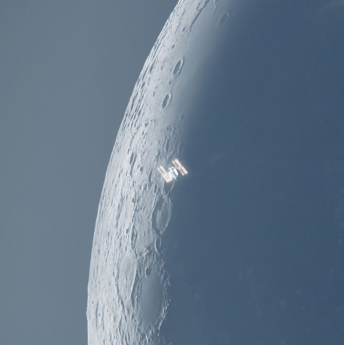 Shot in broad daylight, this image shows the International Space Station transiting a just-illuminated moon crescent. ...