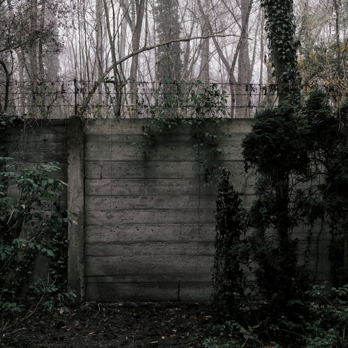 Germany, 2016: A pockmarked wall used as a pistol range and execution site at Dachau concentration ...