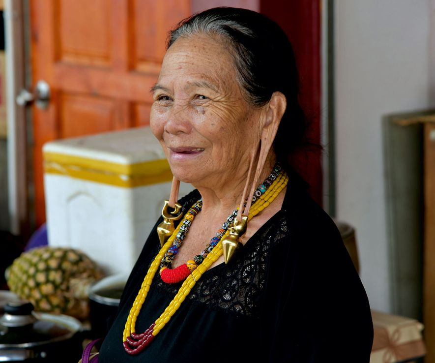 The fashion for extending one's earlobes was once extremely popular among the Kelabit tribe, but Aunty is the last woman to still practice it.