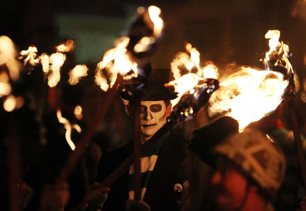 Members of the Lewes Bonfire Society parade through Lewes, southern England, as part of their bonfire ...