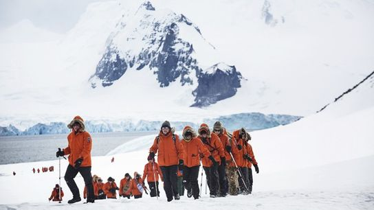 Passengers hike across the landscape at Half Moon Island in the South Shetland Islands. Image: Shaney ...