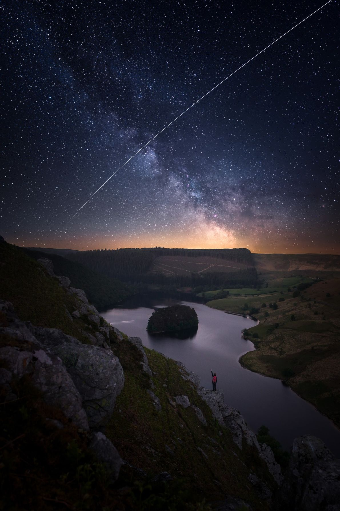 "Alyn Wallace: ""The International Space Station, illuminated by the sun, passes over the night sky in ..."