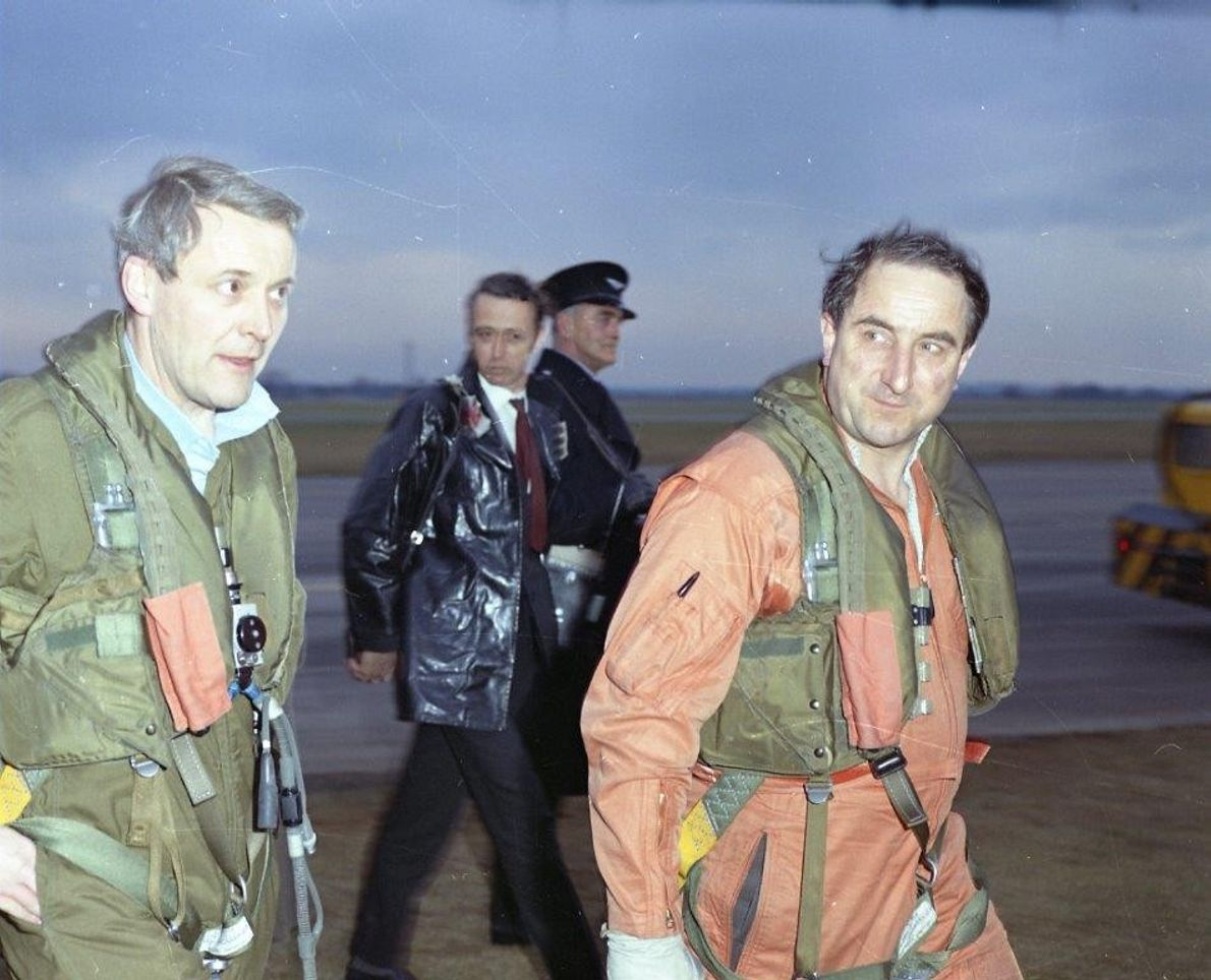 The first British test pilot Brian Trubshaw (right) makes for the plane, 1970. Note parachute. The ...