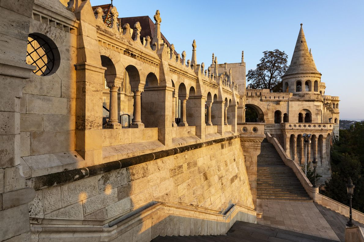 Budapest's morning sunlight hits the Halászbástya, or Fisherman's Bastion. This neo-Gothic and neo-Romanesque terrace on Castle ...