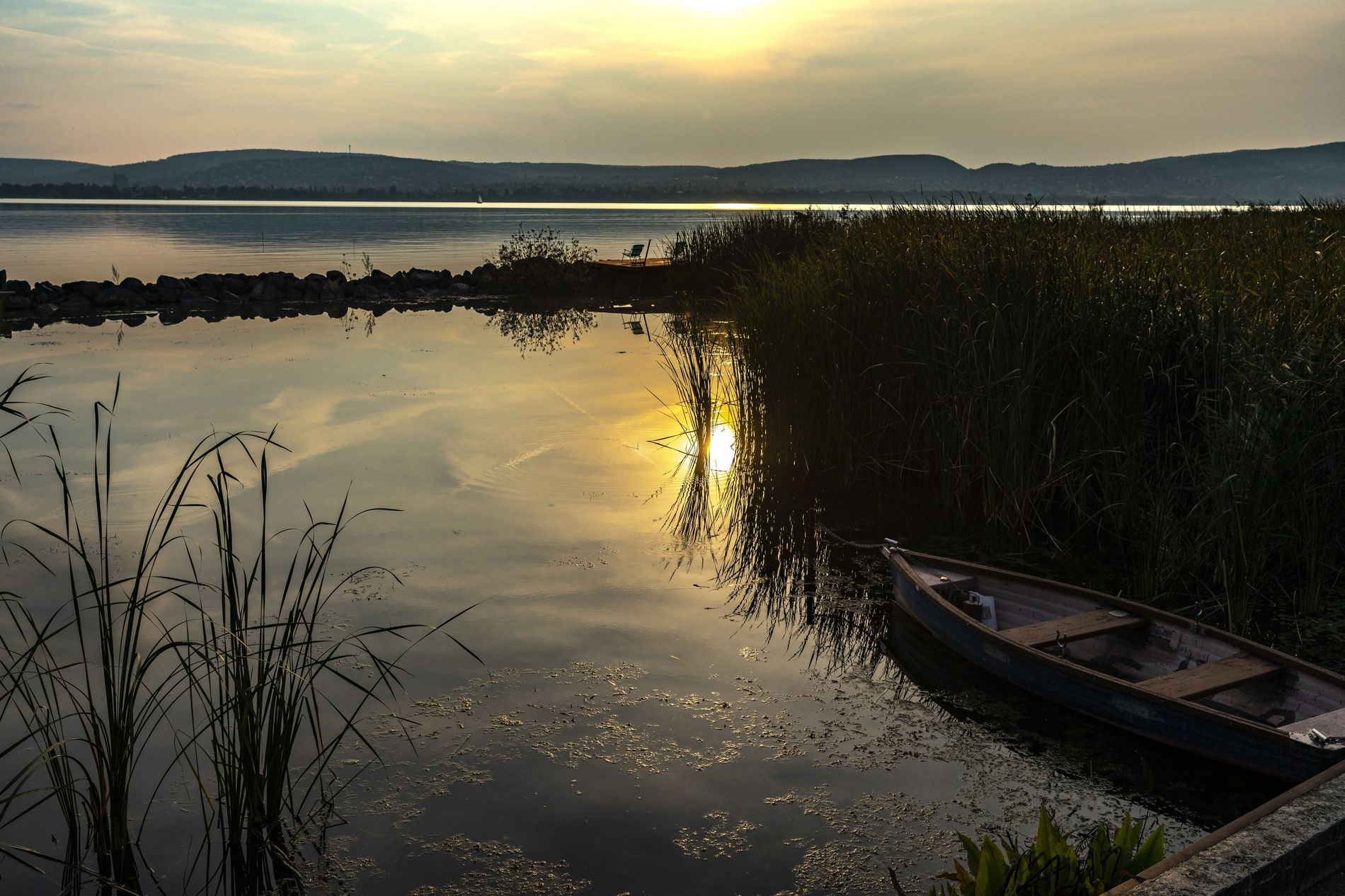 At Lake Balaton, a lone fisherman's boat is done for the day and docked by the ...
