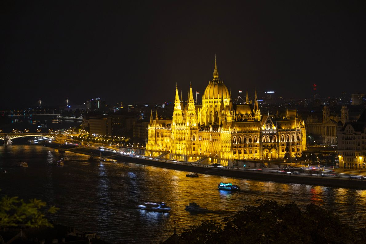 The massive Budapest Parliament building is a stunning landmark at any time of the day, particular ...