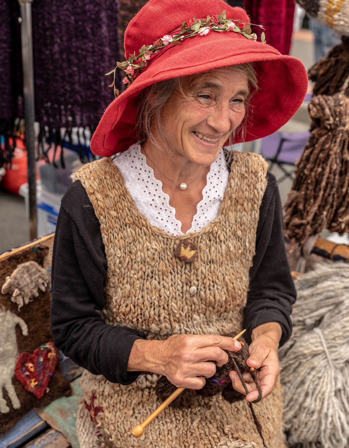 Nicole Thomas Mafreka, a sheepherder and weaver, is all smiles at the Nelson Market, a gathering …