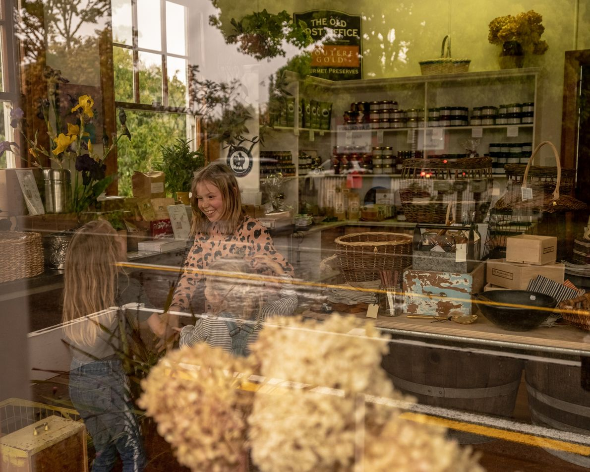 A trio of local girls in Upper Moutere's Old Post Office now converted into a shop. ...