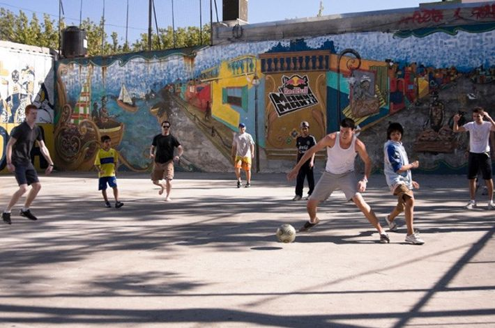 People playing football together