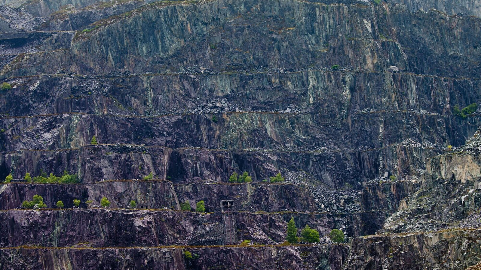 Disused quarry terraces above Llanberis. The town of Llanberis, in north-west Snowdonia, is also the base ...