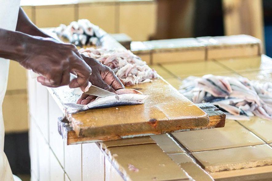 Preparing flying fish for sale at Bridgetown Fish Market, Barbados