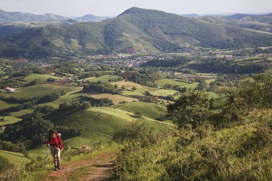 Hiker heading into the Pyrenees from Saint-Jean-Pied-de-Port, Camino de Santiago