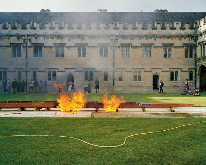 Oxford: at the University's St. John's College, a ceremonial boat burning in Canterbury Quadrangle to celebrate ...